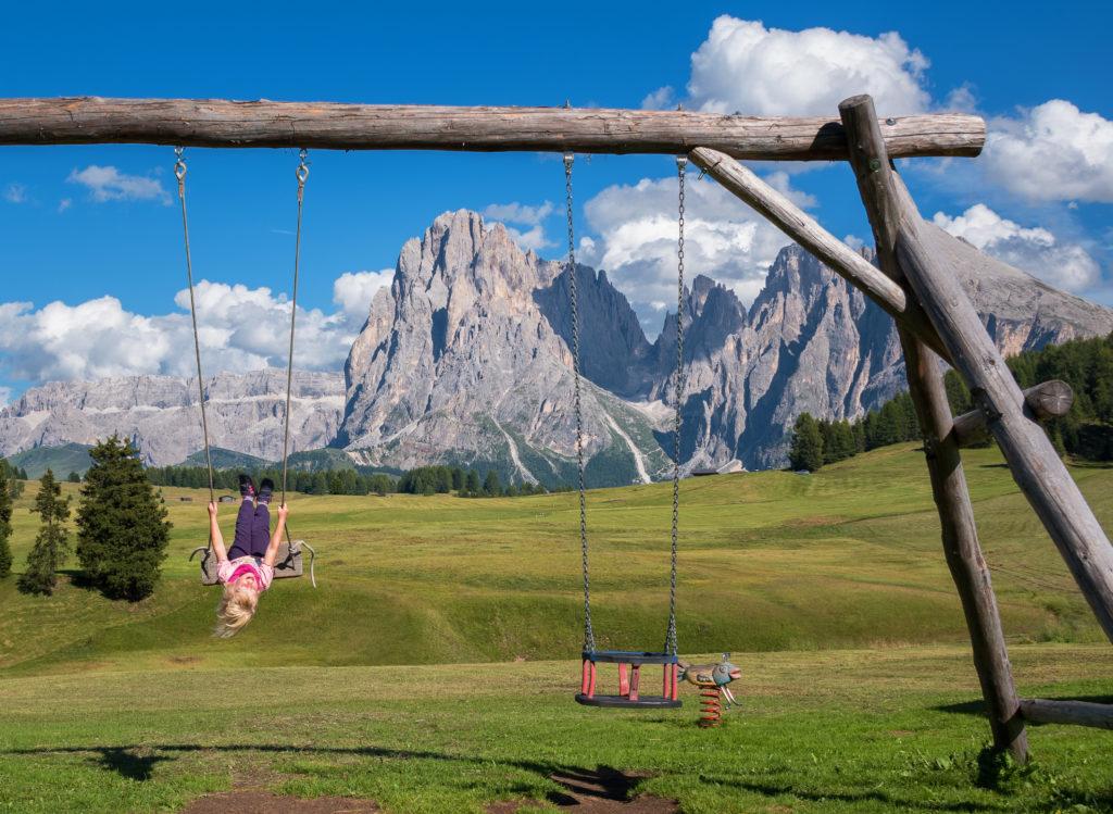 Canva Little Girl on aSwing in the Mountain Landscape 1024x749 - Lato/ Zima